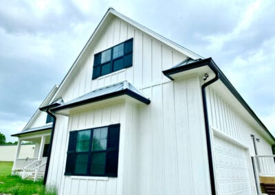 black gutter used as trim on new construction